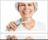Old Women Brushing Teeth